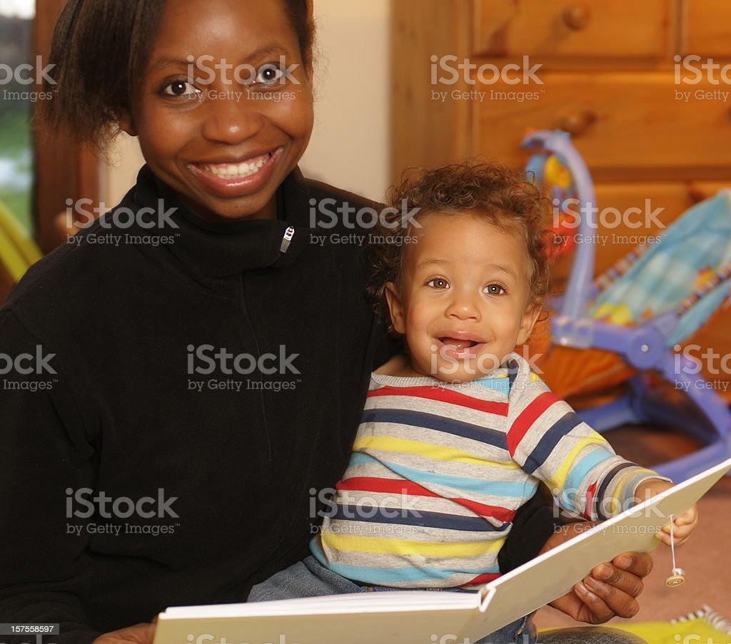 African American woman and her son during storytime royalty-free stock photo