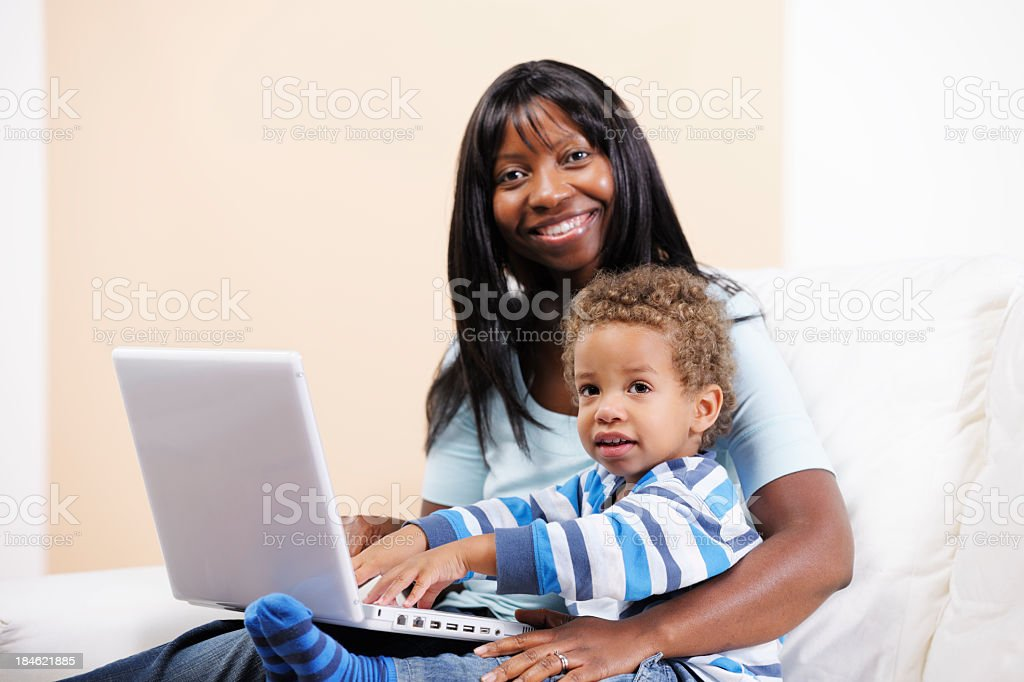 African American Woman And Toddler/ Son Using The Computer royalty-free stock photo