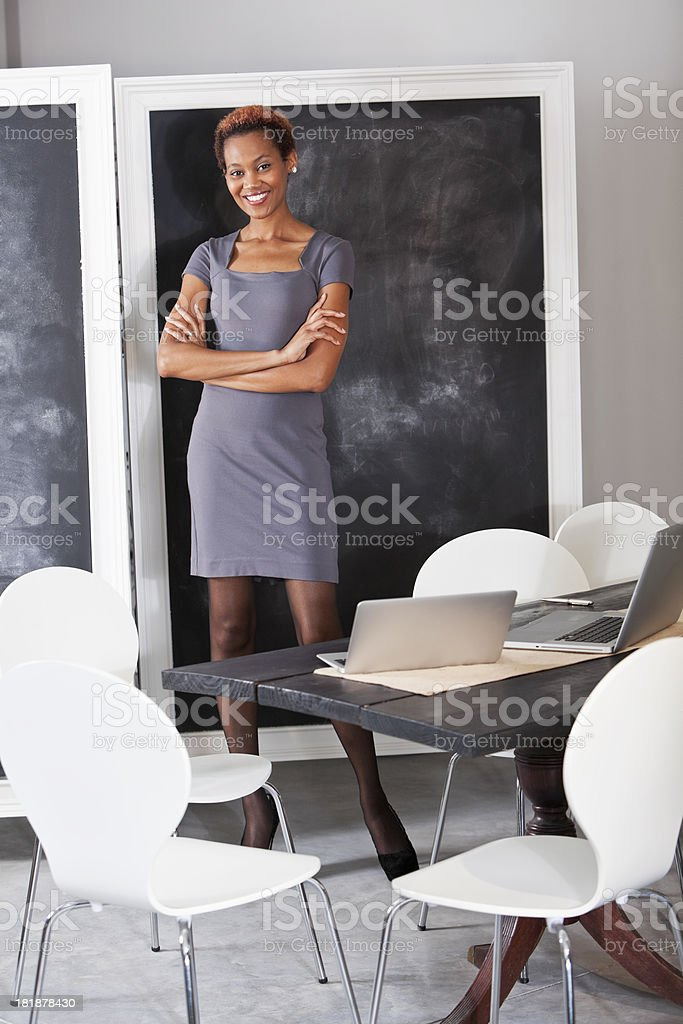 African American woman at blackboard stock photo