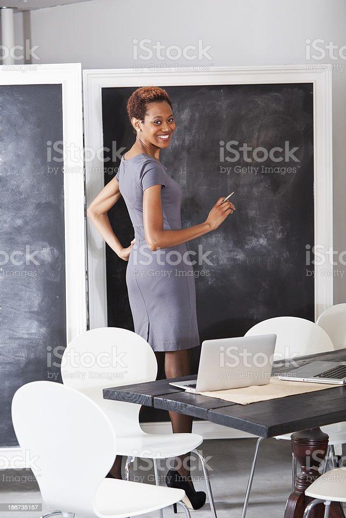 African American woman at blackboard royalty-free stock photo