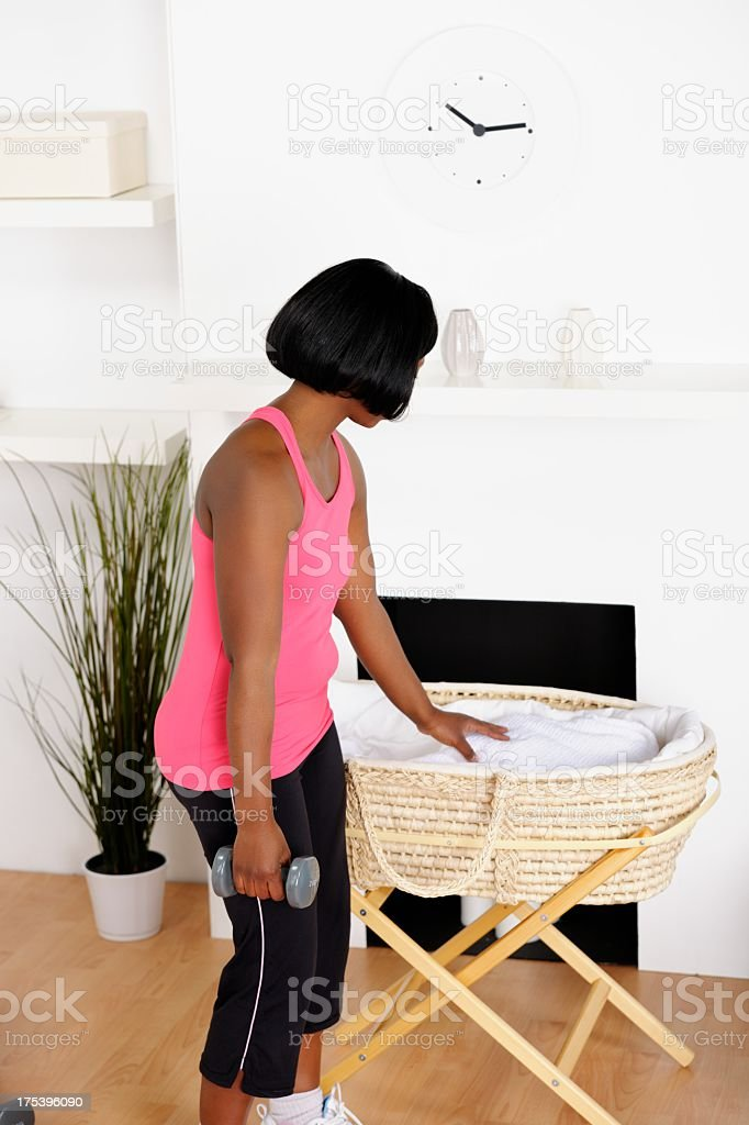 African American Woman Balancing Childcare And Post Natal Exercise stock photo