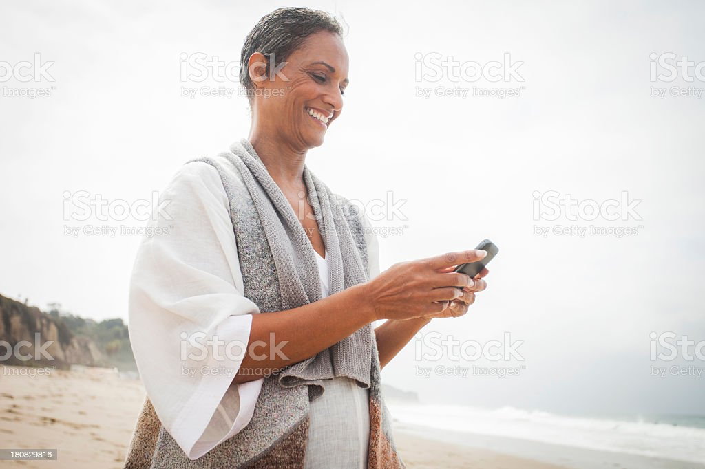 African American Woman Checking Smartphone stock photo