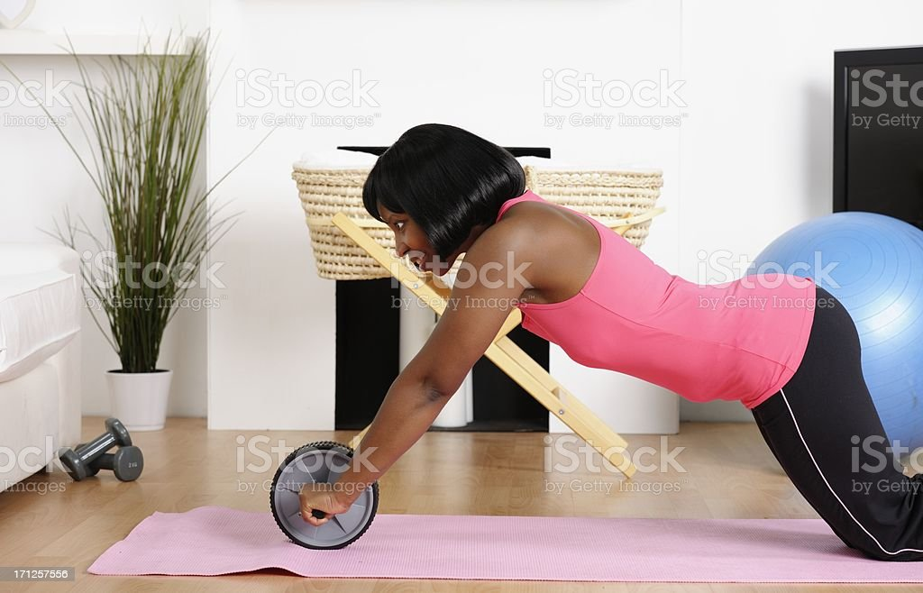 African American Woman Exercising at Home stock photo