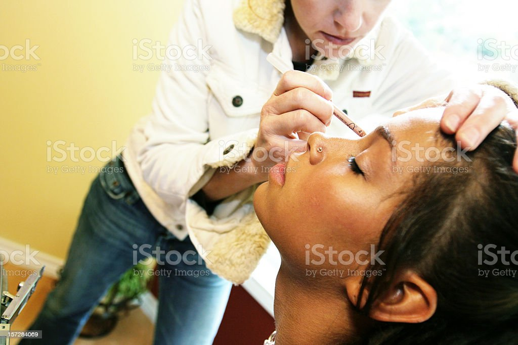 African American Woman Getting a Makeover royalty-free stock photo