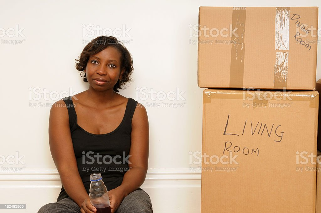 African American Woman Having A Break During Moving royalty-free stock photo