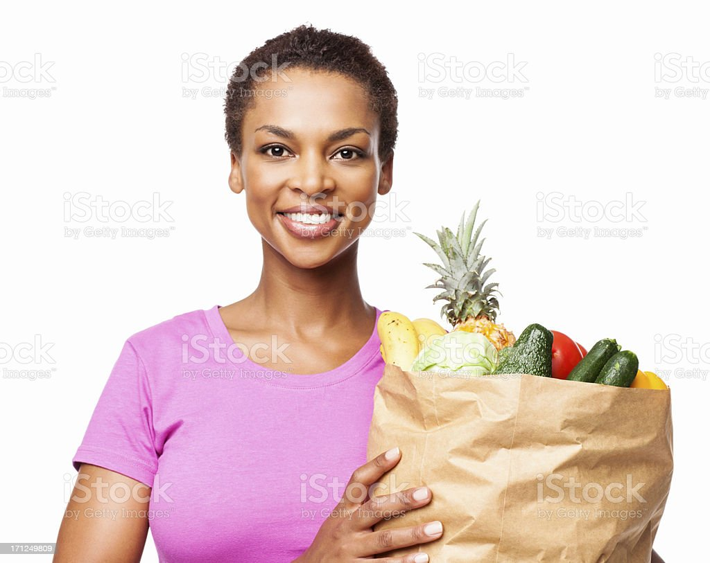 African American Woman Holding Bag Of Groceries - Isolated royalty-free stock photo
