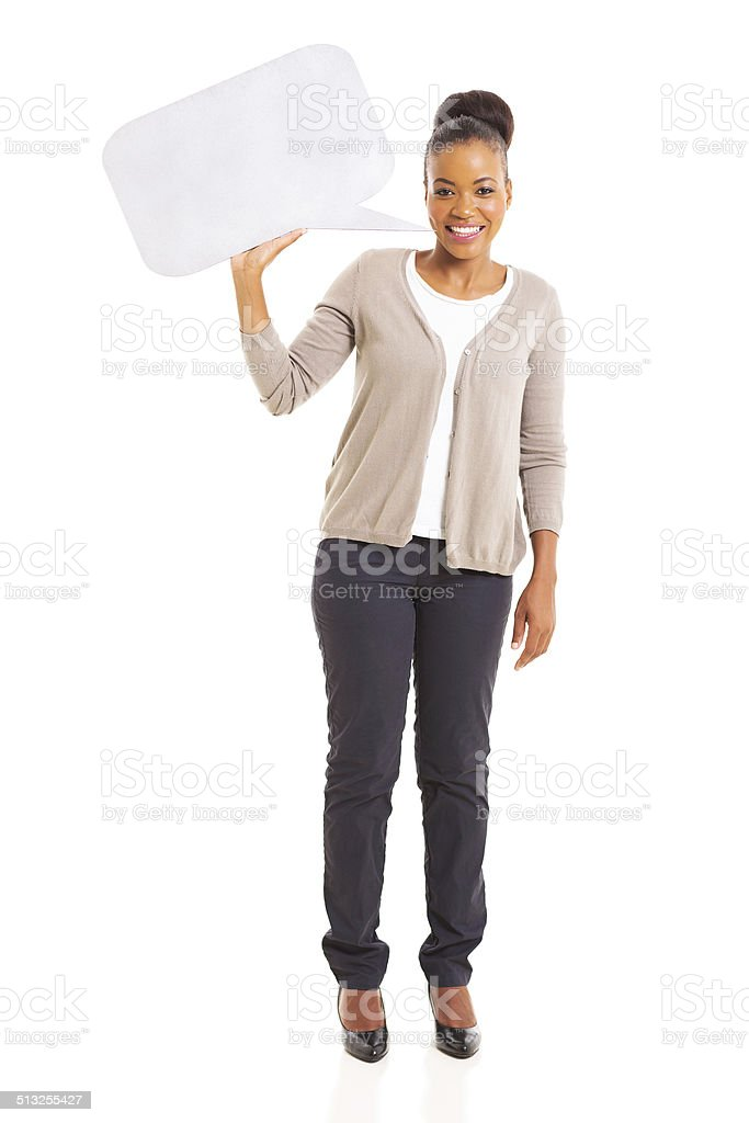african american woman holding blank speech bubble stock photo