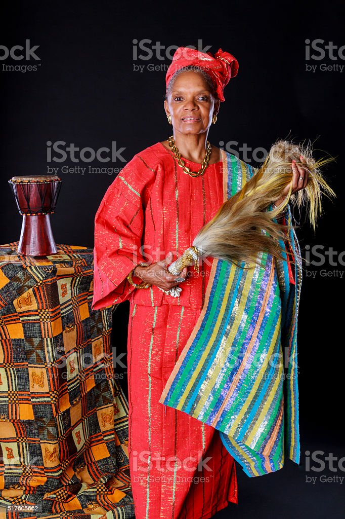 African American Woman In Colorful Red Attire stock photo