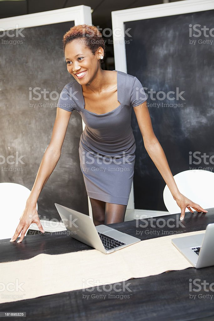 African American woman in front of blackboard stock photo