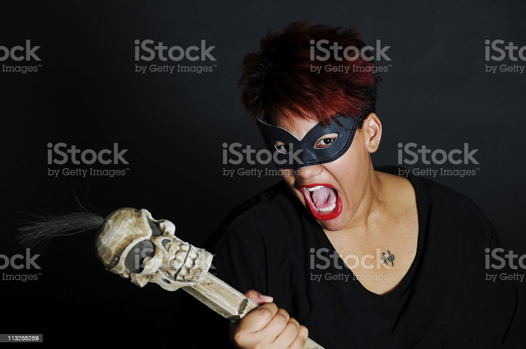 African American Woman in  Mask  mouth Open Isolated on Black stock photo