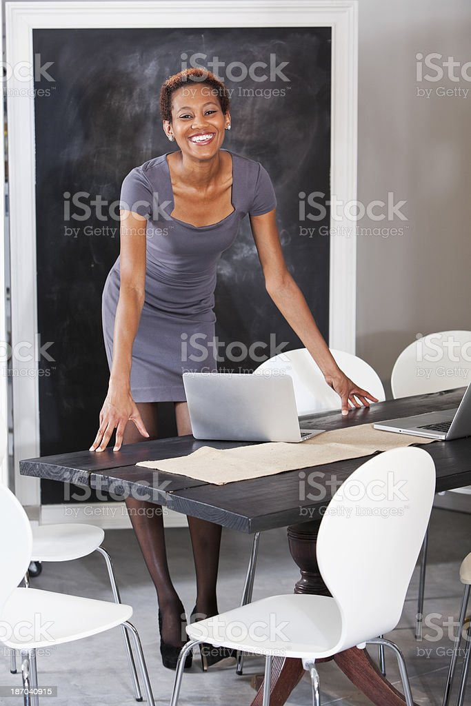 African American woman in meeting room stock photo