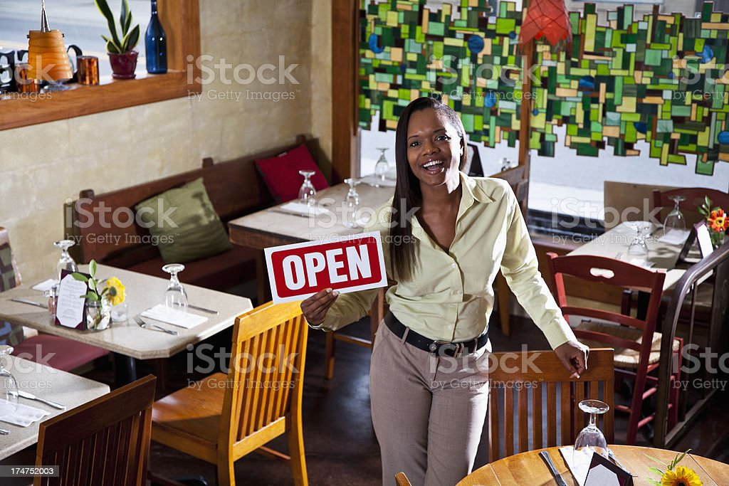 African American woman in restaurant open for business royalty-free stock photo