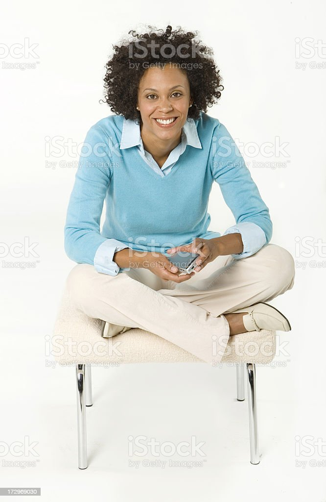 African American Woman on White Seamless with a portable royalty-free stock photo