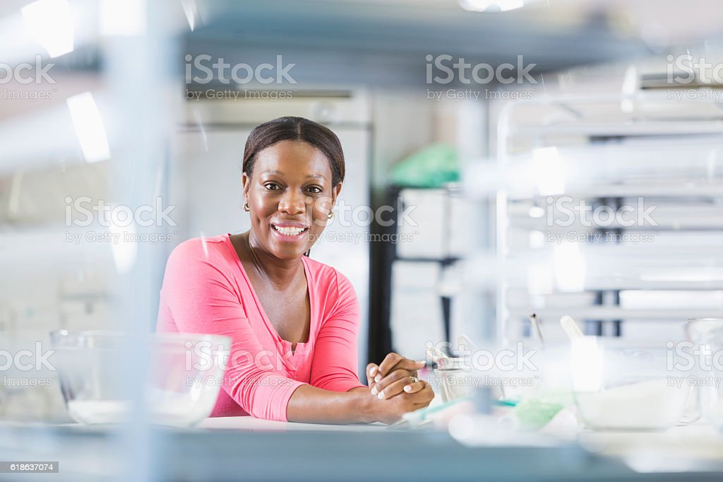 African American woman, owner of small restaurant business stock photo