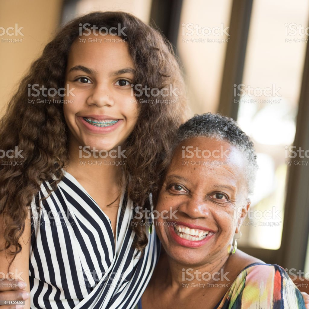 African american woman posing with her granddaughter stock photo