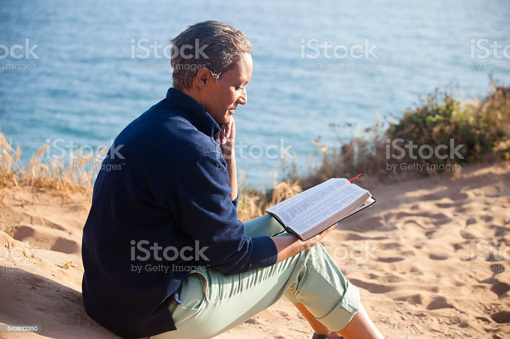African American Woman Reading Bible stock photo
