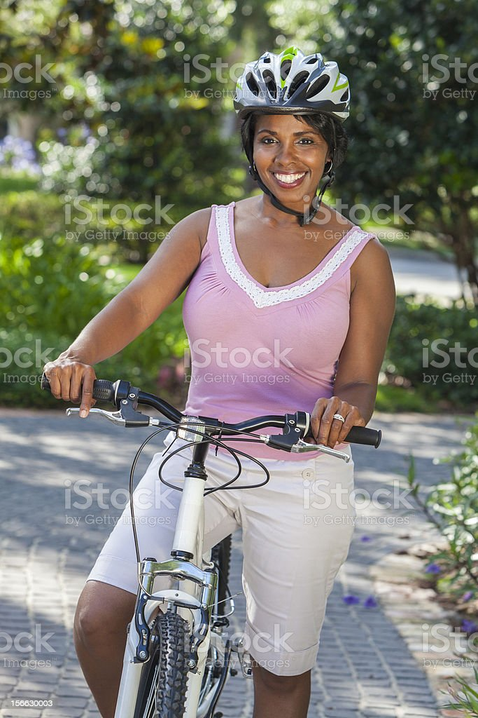 African American Woman Riding Bike Bicycle Cycling royalty-free stock photo