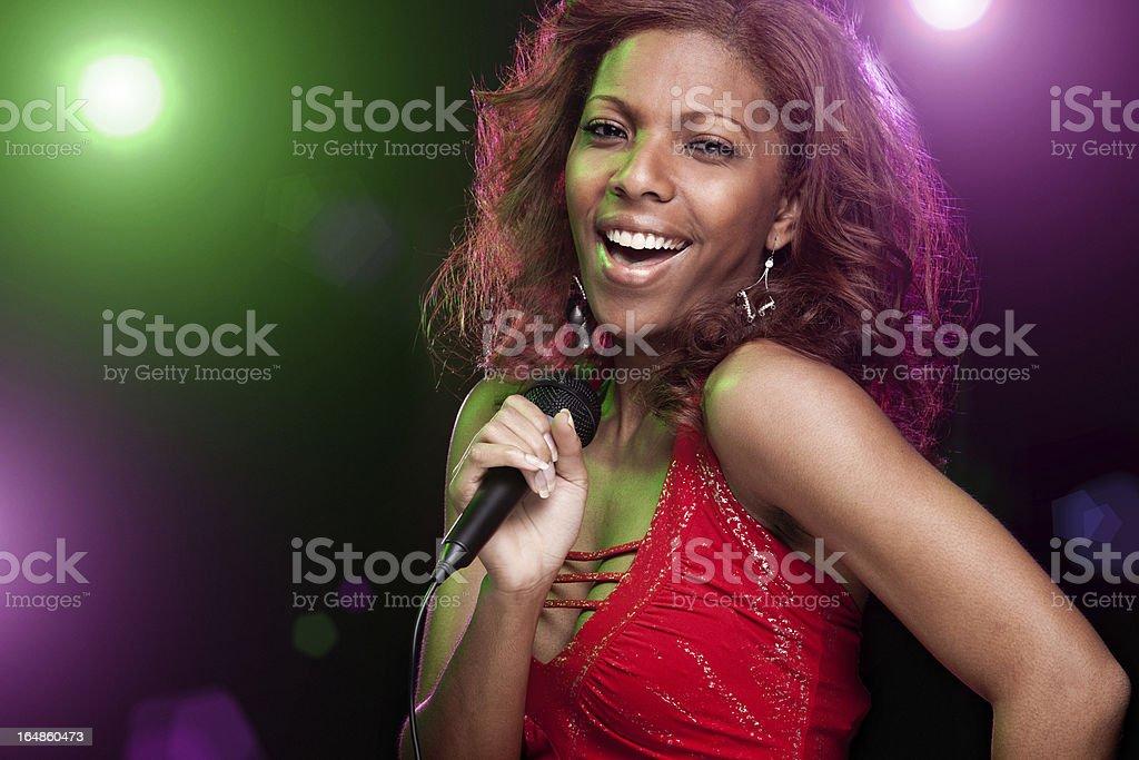 African American Woman Singing Karaoke on Stage royalty-free stock photo