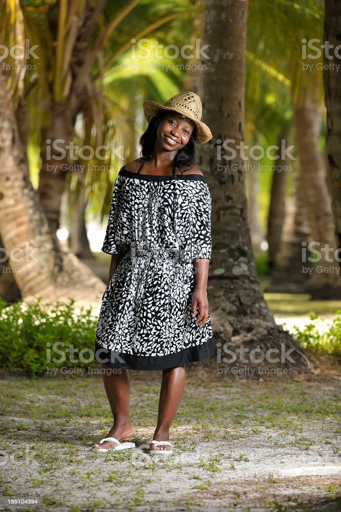 African American Woman Taking A Break Amongst The Palm Trees. stock photo