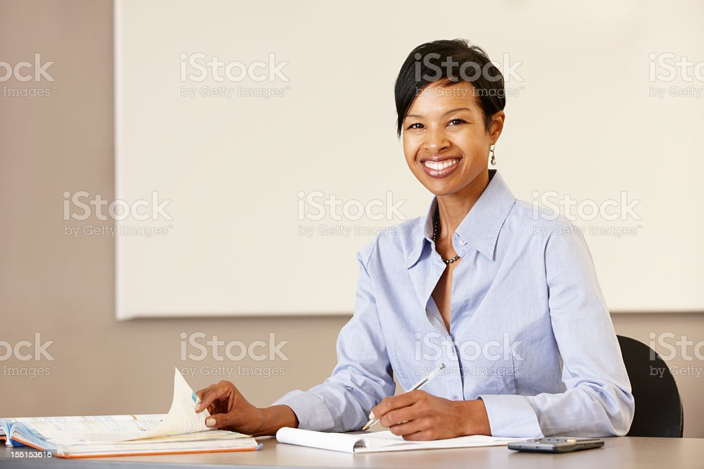 African American woman teaching working at desk royalty-free stock photo