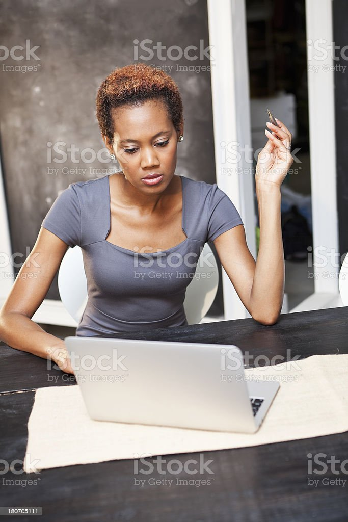 African American woman using laptop stock photo