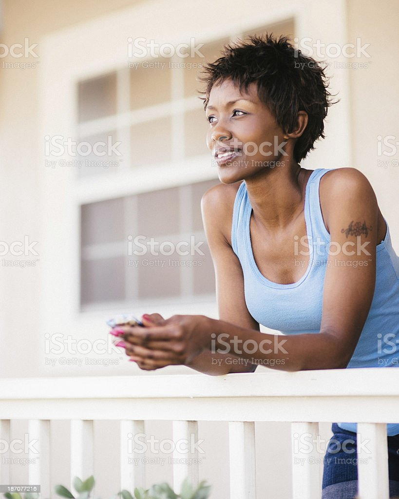 African american woman using smartphone royalty-free stock photo