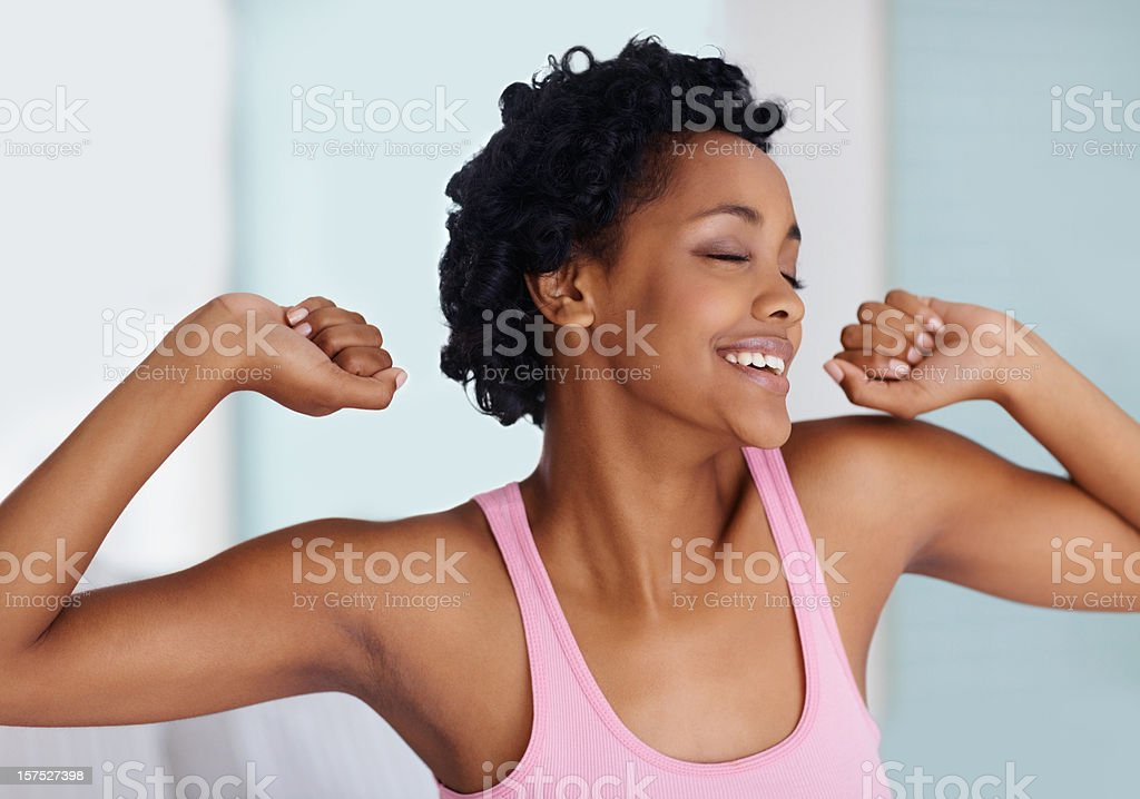 African American woman waking up with a morning stretch royalty-free stock photo