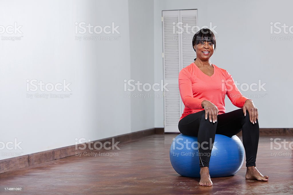 African American woman with fitness ball stock photo
