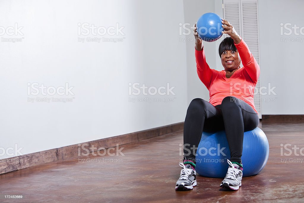 African American woman with fitness balls stock photo