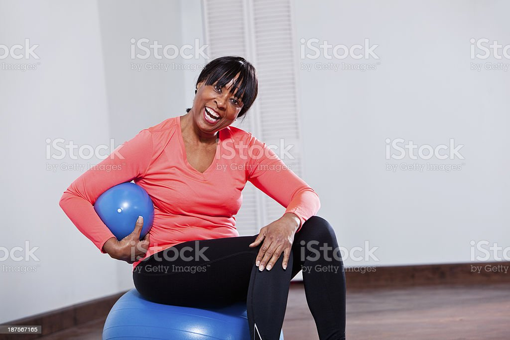 African American woman with fitness balls royalty-free stock photo