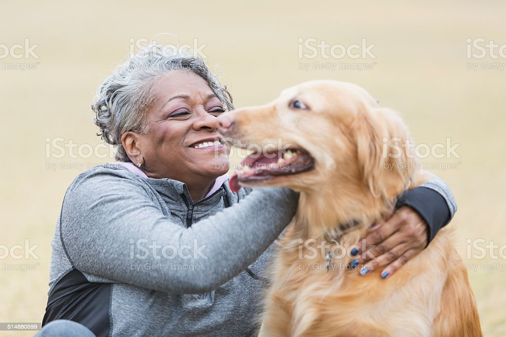 African American woman with pet dog stock photo