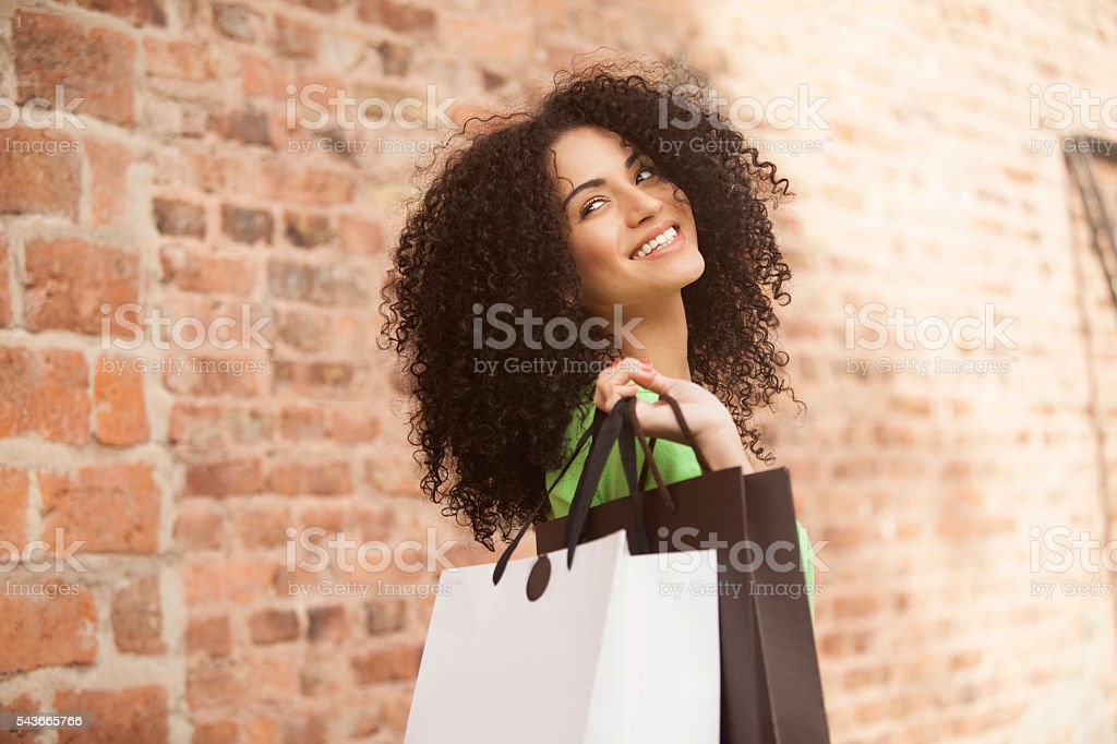 African american woman with shopping bags stock photo