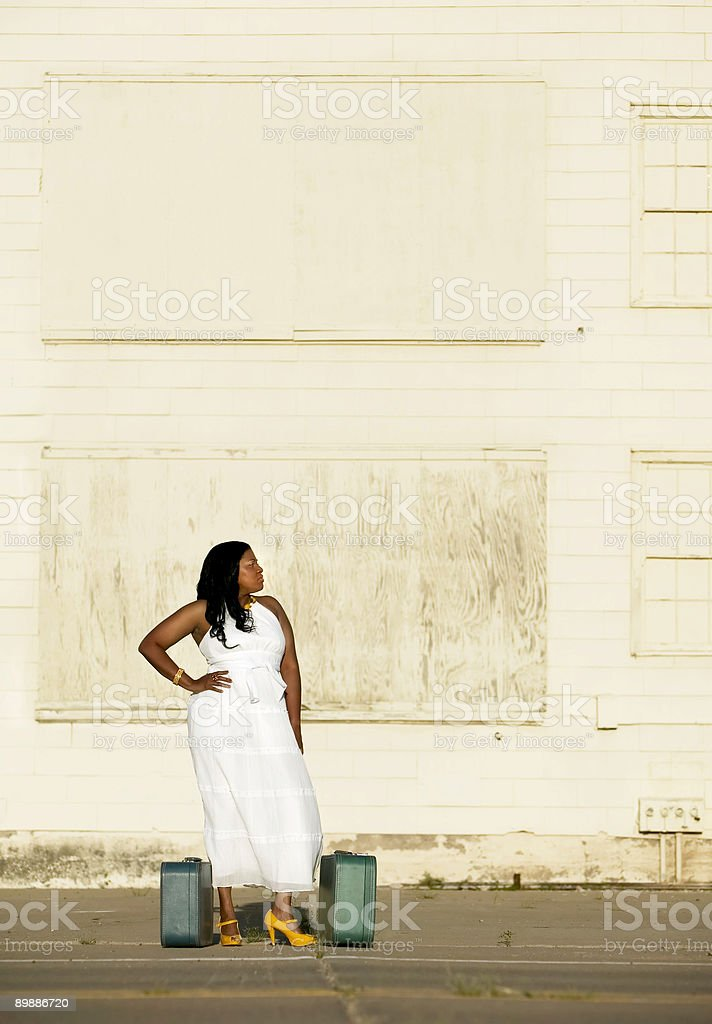 African American woman with suitcases royalty-free stock photo
