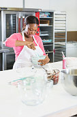 African American woman working in bakery kitchen