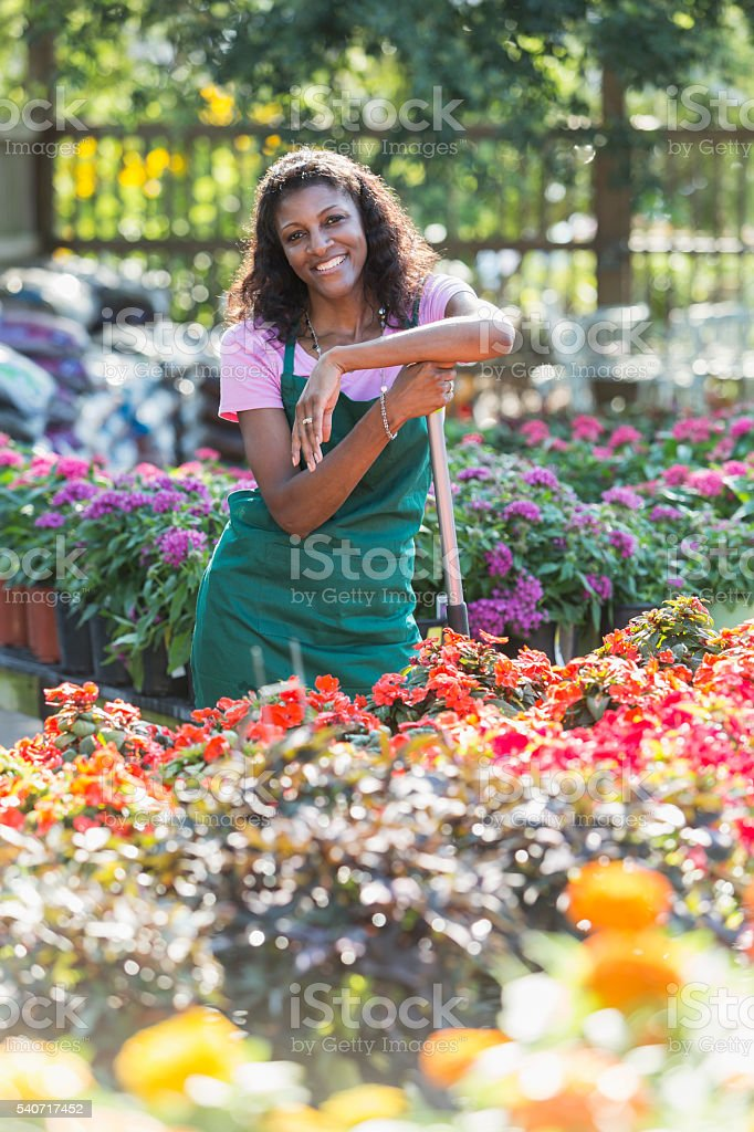 African American woman working in plant nursery stock photo