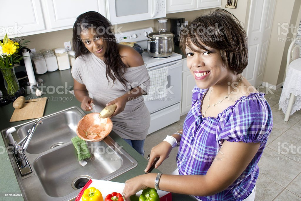 African American Women Cooking Together in the Kitchen royalty-free stock photo