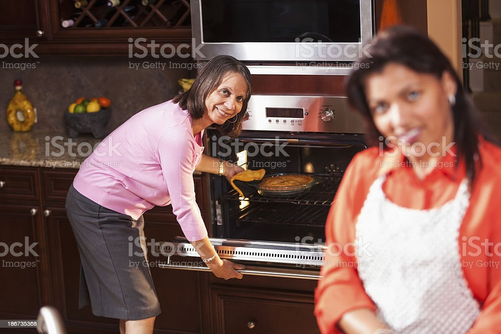 African American women in kitchen stock photo