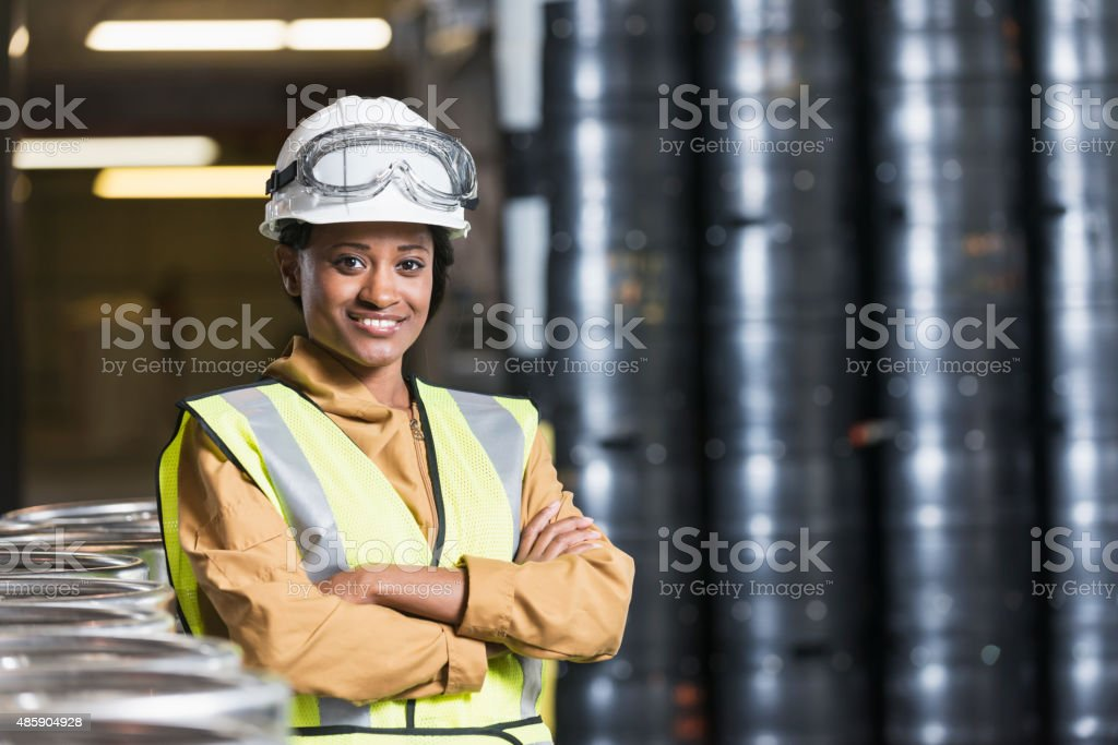 African American worker in storage warehouse stock photo