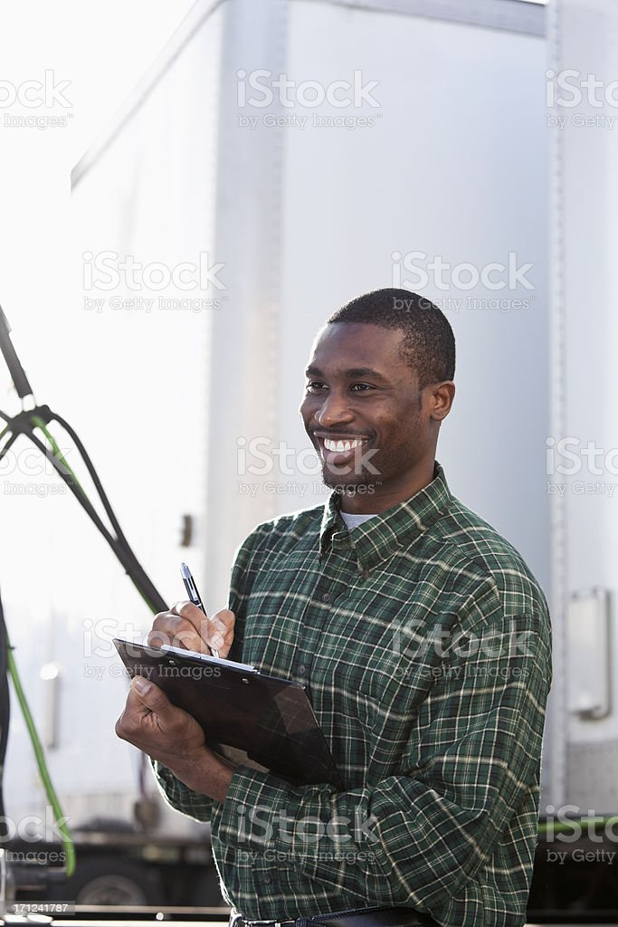 African American worker with clipboard stock photo