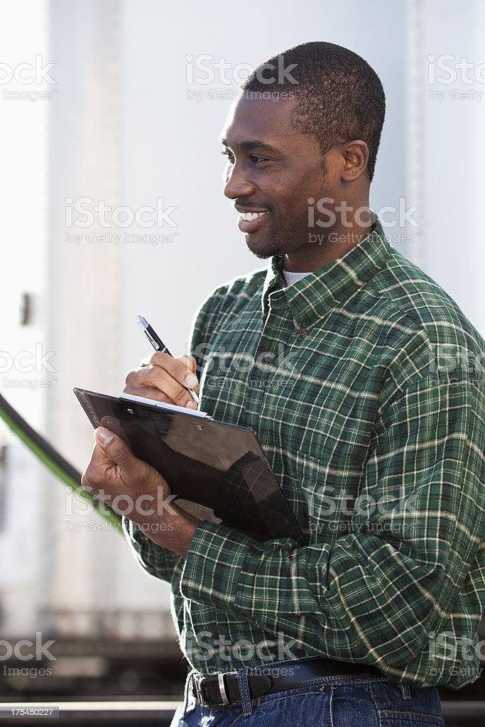 African American worker with clipboard royalty-free stock photo