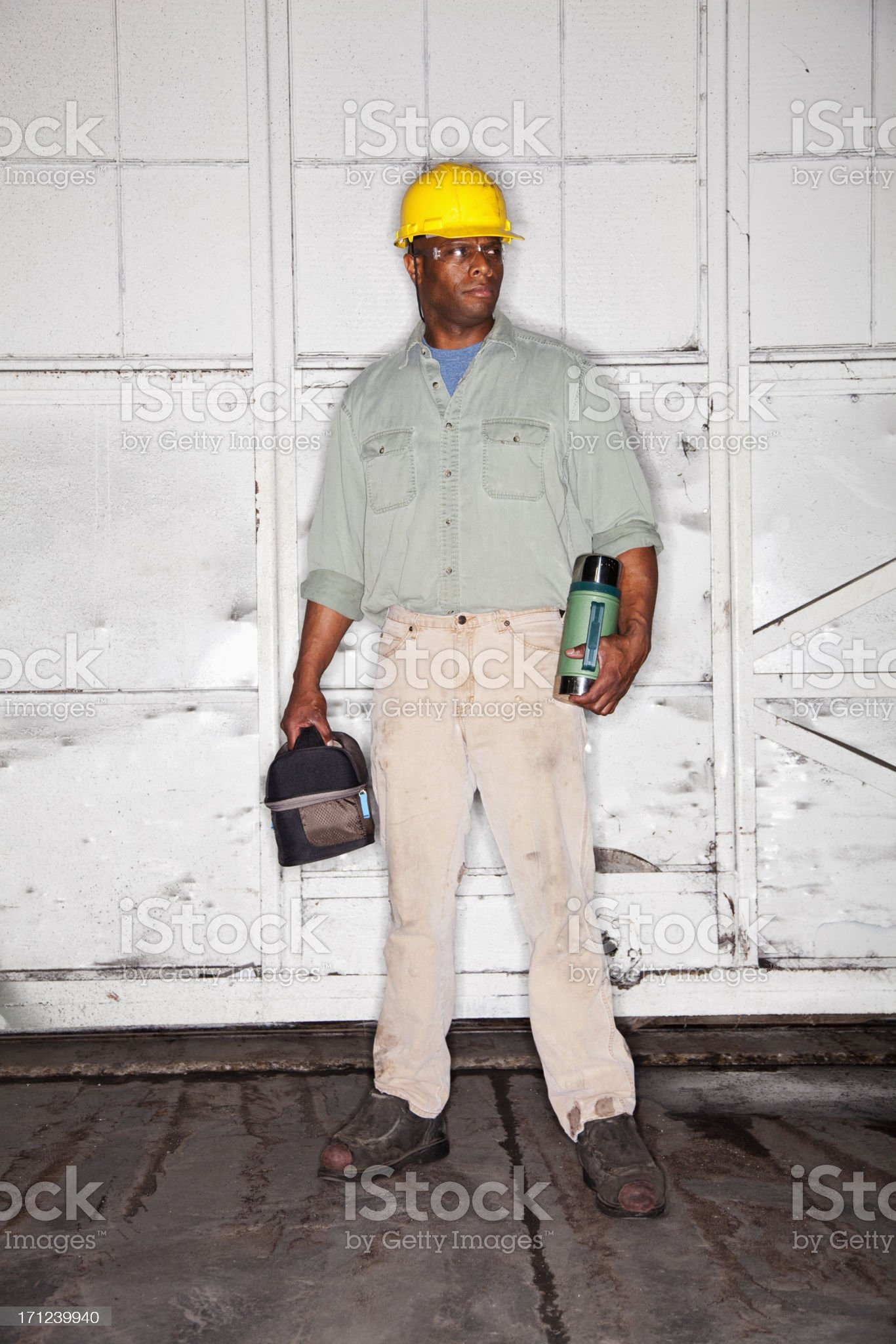 African American worker with lunchbox royalty-free stock photo