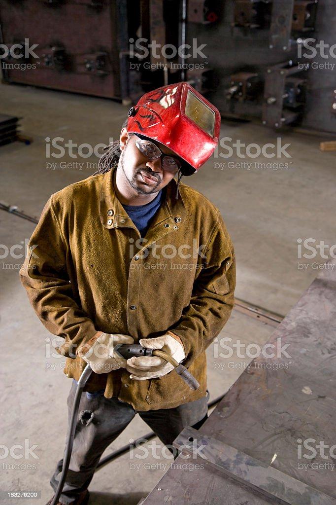 African American worker with welding equipment stock photo