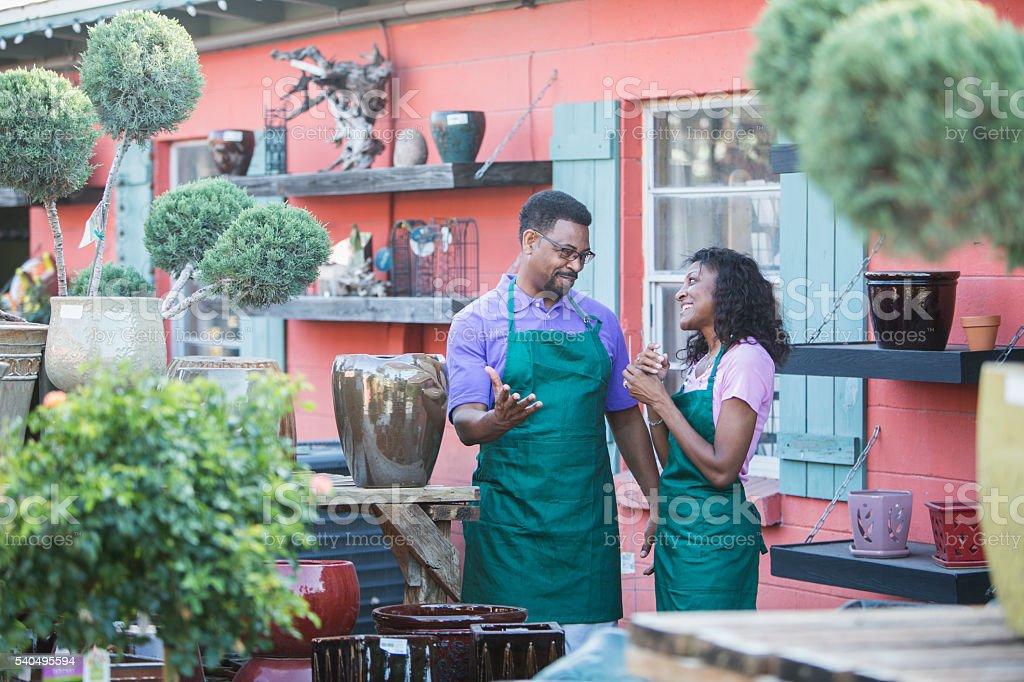 African American workers in garden center stock photo