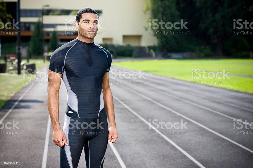 African American Young Male Athlete on Running Track, Copy Space royalty-free stock photo