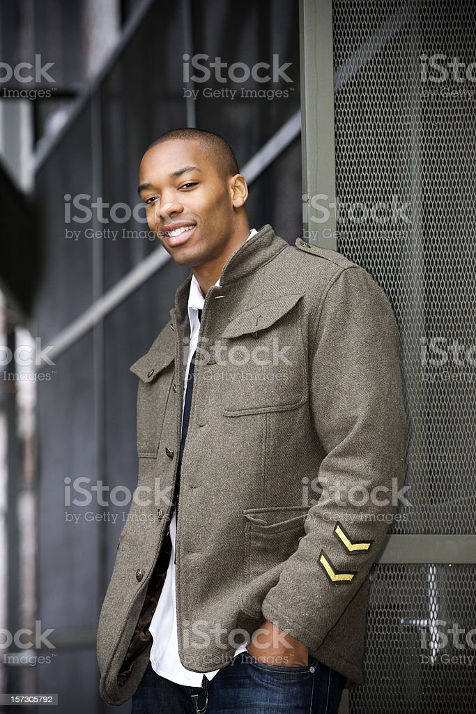 African American Young Male Fashion Model Posing Downtown in Jacket stock photo