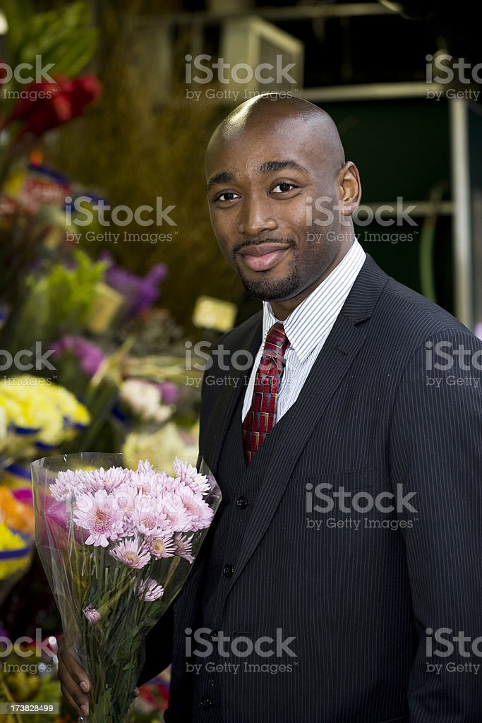 African American Young Man Buying Flower Bouquet Outside royalty-free stock photo