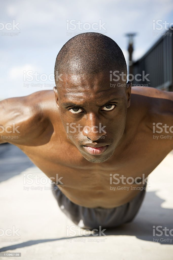 African American Young Man in Push Up, Exercising on Rooftop royalty-free stock photo