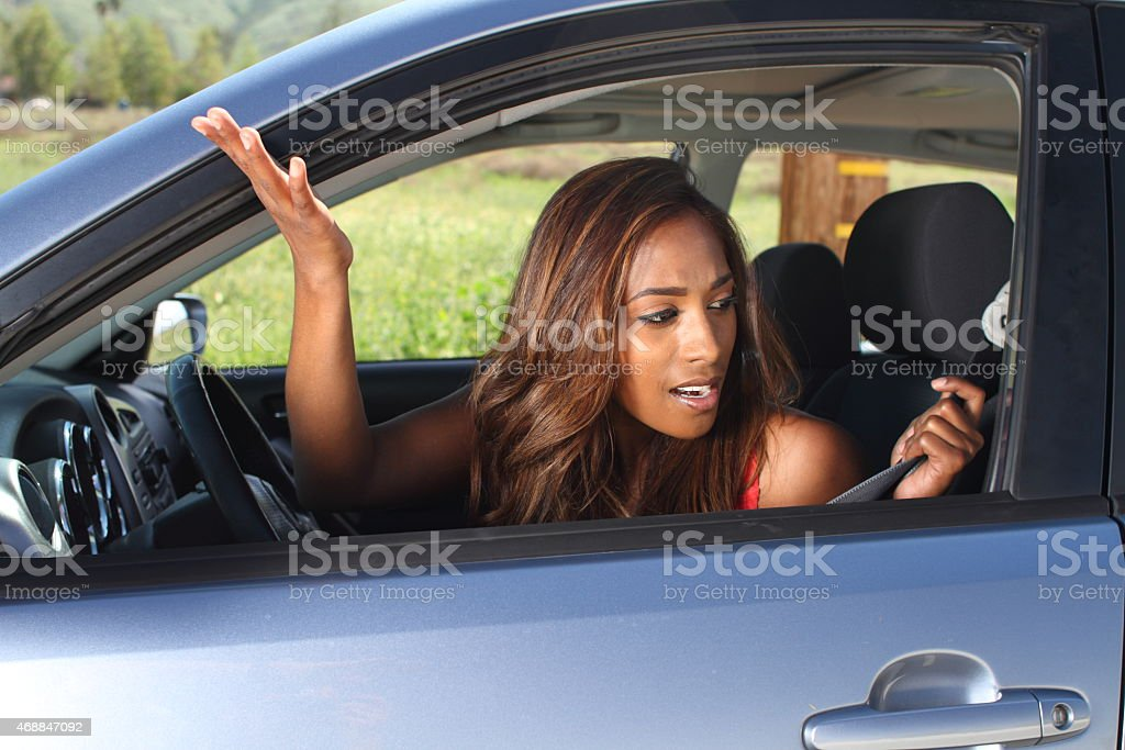 African American Young Road Rage Driver Yells Out Window stock photo