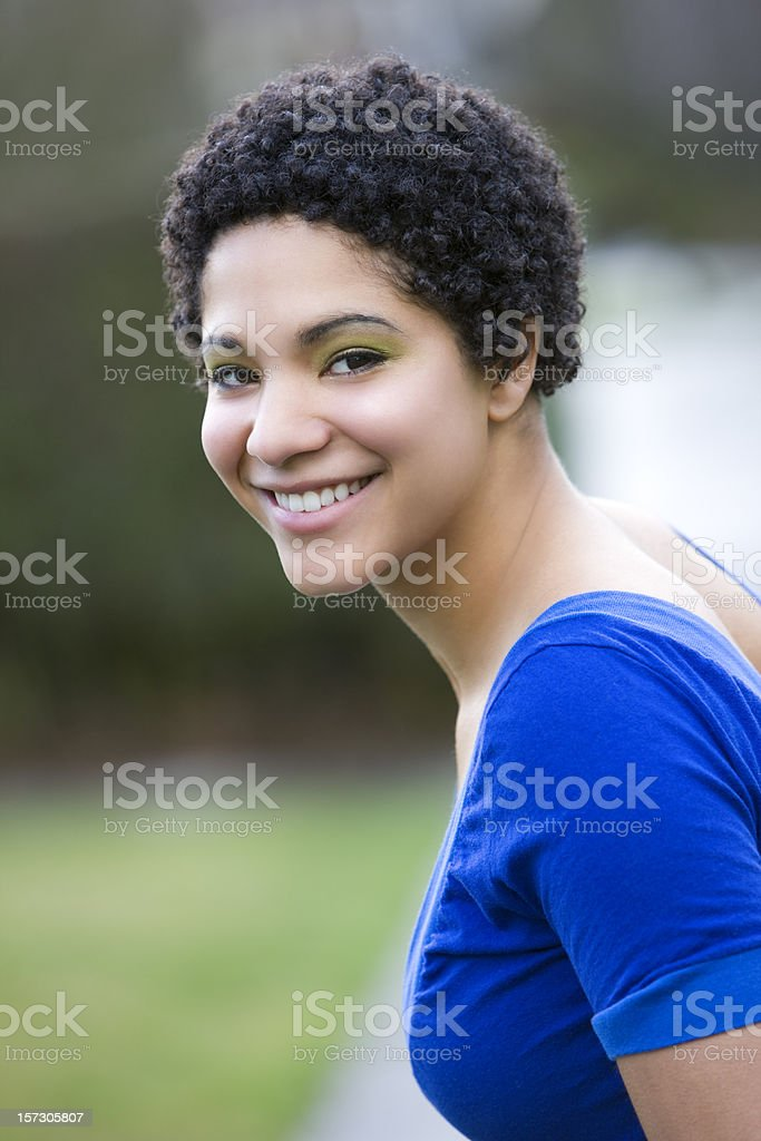 African American Young Woman Portrait Over Shoulder, Outside royalty-free stock photo
