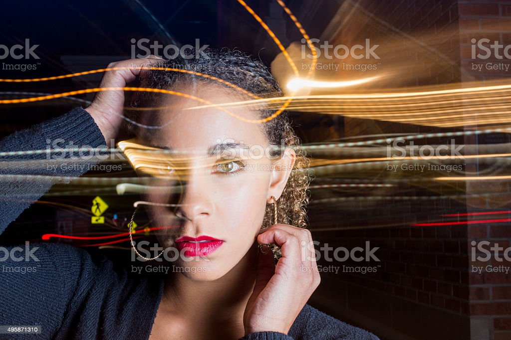 African American Young Woman Portrait with Light Trails stock photo